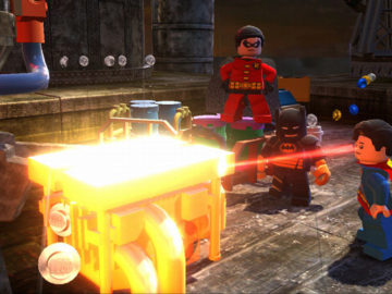 Lego Superman melting an iron chest with his laser vision, while Lego Batman and Lego Robin look on.