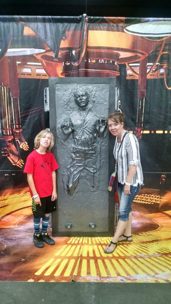 Blogger Jamie Moesser and her son, posed around a replica of Han Solo frozen in carbonite.