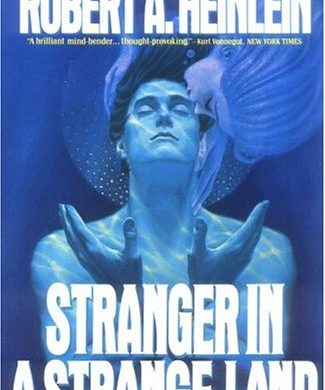 "A man underwater, with hands in a prayer-like gesture, above the words ""Stranger in a Strange Land"""